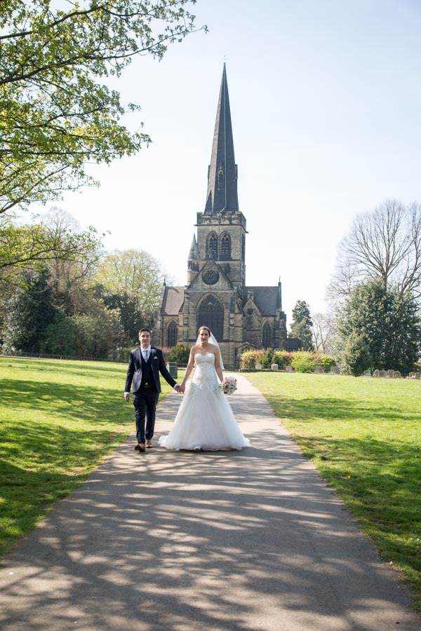 Bride and groom walking down the path outside Wentworth Church