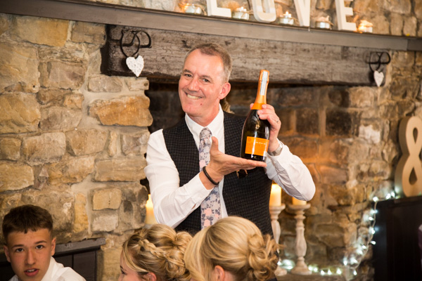THe Fathe rof the bride with a bottle of prosecco at The Rockingham Arms Wentworth