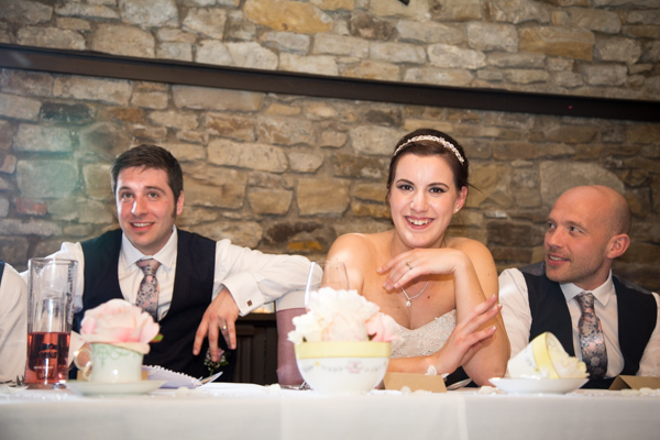 The top table laughing at the wedding speeches at The Rockingham Arms Wentworth
