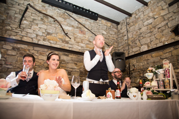 Top table laughing during the wedding speeches at The Rockingham Arms Wentworth
