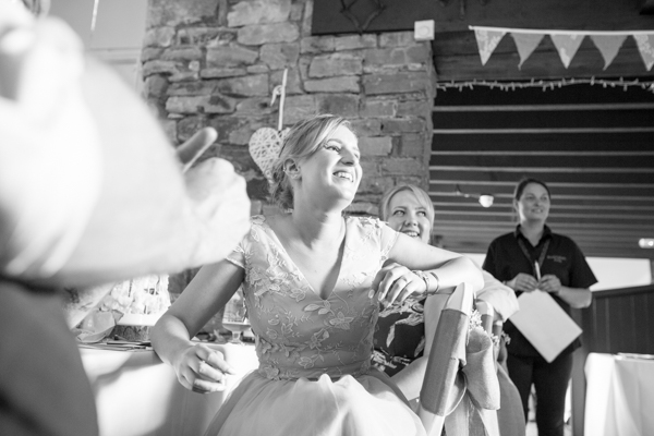 Bridesmaid laughing during speeches at The Rockingham Arms Wentworth