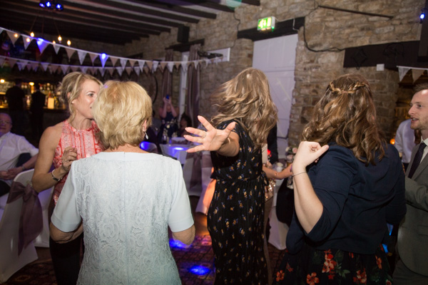 Guests dancing during the wedding reception at The Rockingham Arms
