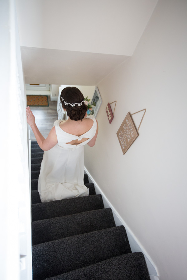 Bride to be walking down the stairs