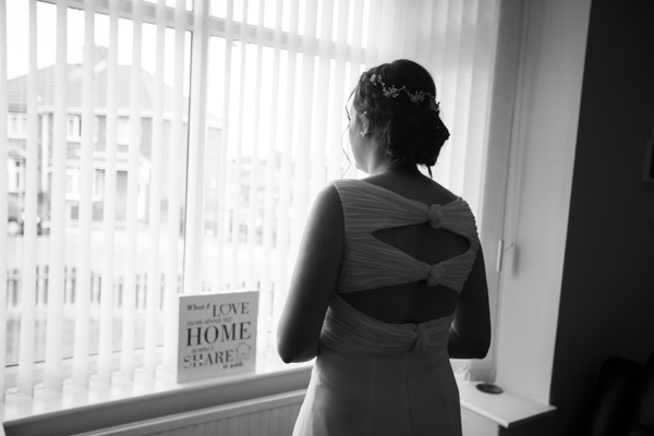 Bride to be looking out of her window before the ceremony