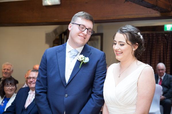 Bride and Groom smiling during the wedding ceremony at Tankersley Manor Hotel Wedding