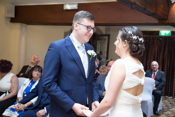 Bride and Groom exchange vows during wedding ceremony at Tankersley Manor Hotel Wedding