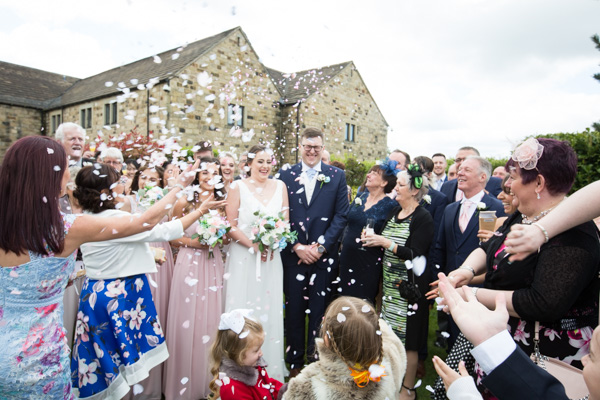 The wedding party throwing confetti at Tankersley Manor Hotel Wedding
