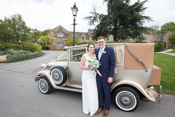 Bride and Groom next to the wedding car at Tankersley Manor Hotel Wedding