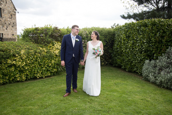 Bride and Groom walking in the grounds of Tankersley Manor Hotel Wedding