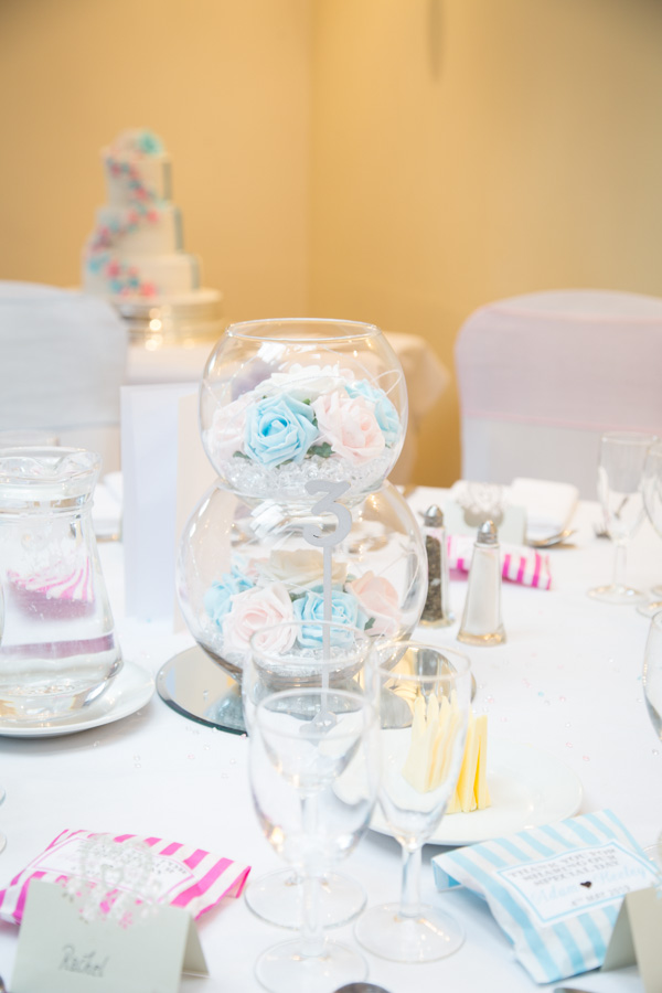 Pink and blue flower centrepieces at Tankersley Manor Wedding