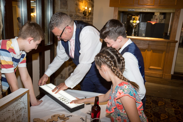 Guests changing wedding light sign at Tankersley Manor Wedding