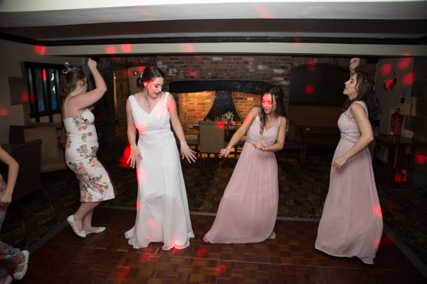 Bride and Bridesmaids dancing at Tankersley Manor Wedding