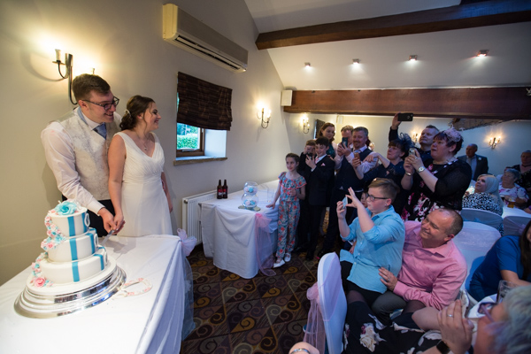 Bride and Groom cutting the cake at Tankersey Manor Wedding