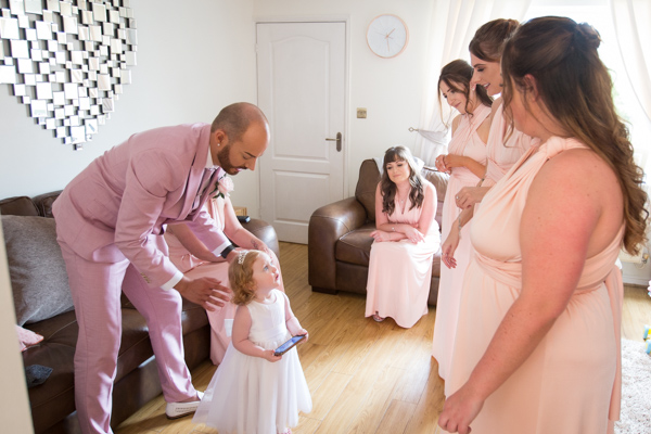 Bridesmaids getting ready with flower girl