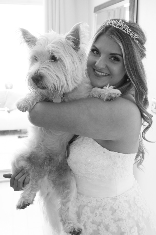 Bride and her dog on the wedding day
