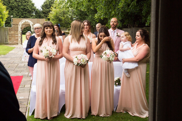Bridesmaids crying at Holiday Inn Barnsley Outdoor ceremony
