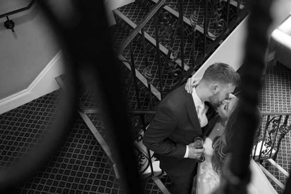 Bride and Groom kissing on the stairs at Holiday Inn Barnsley Wedding