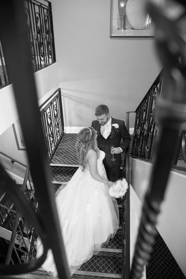 Bride and Groom standing on the stairs at Holiday Inn Barnsley Wedding
