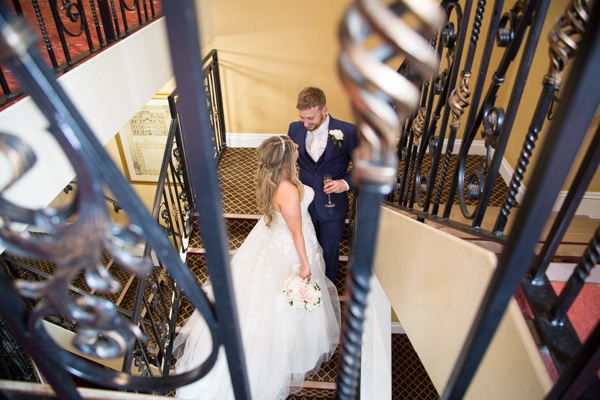 Bride and Groom talking on the stairs at Holiday Inn Barnsley Wedding