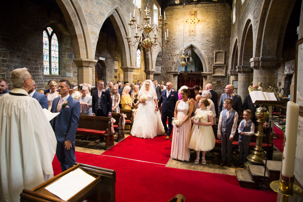 Bride walking down the aisle at Wath church