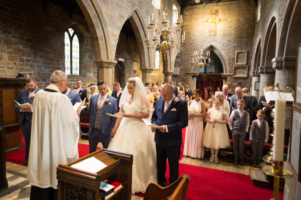 Wedding guests singing hymns at Wath church