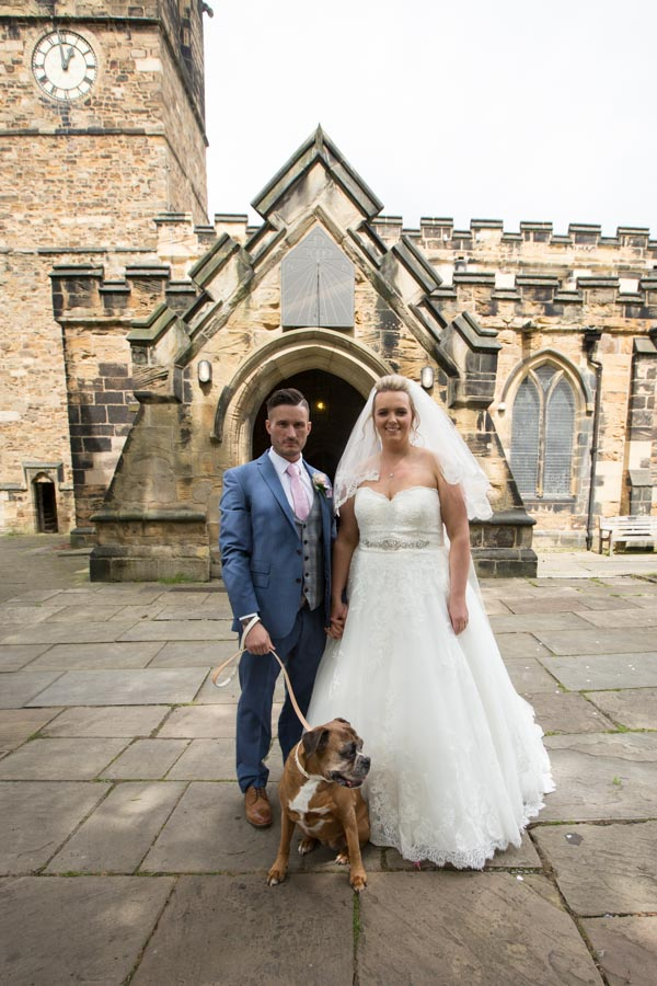 Bride and Groom with Meg the dog outside Wath church