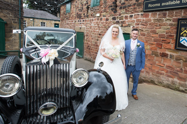 Bride and Groom with wedding car at Rockingham Arms Wentworth