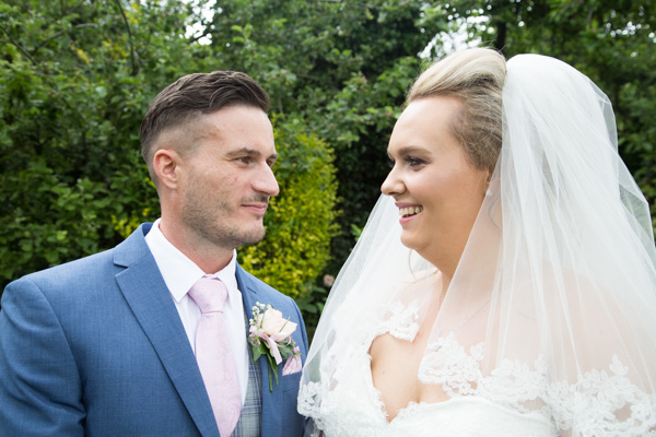 Bride and Groom laughing at Rockingham Arms Wentworth