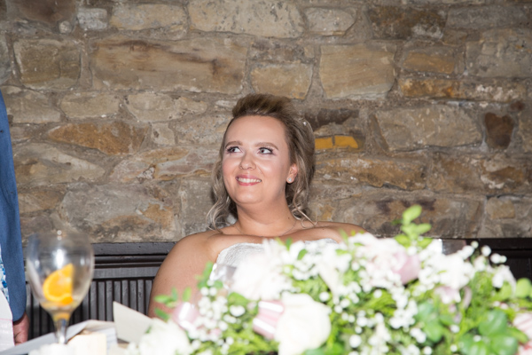 Bride smiling during wedding speeches at Rockingham Arms Wentworth