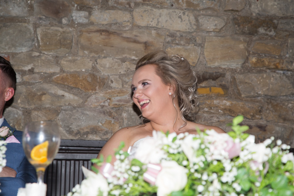 Bride laughing at the top table at Rockingham Arms Wentworth