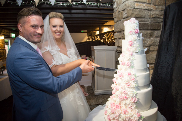 Bride and Groom cutting wedding cake at Rockingham Arms Wentworth