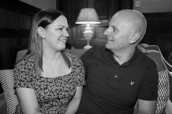 Couple look at each other on their pre-wedding session at whitley hall hotel