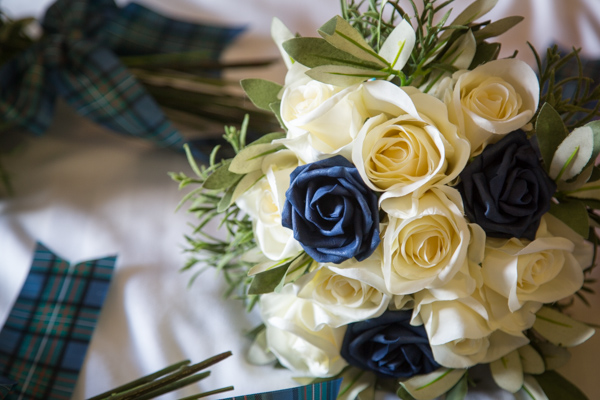 Blue and White silk roses at Bluebell Banqueting Suite Barnsley Wedding