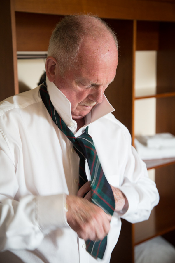 Groom fastening his tie at Bluebell Banqueting Suite Barnsley Wedding