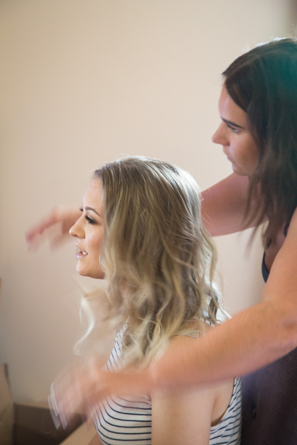 Hairdresser doing bridesmaid hair at Bluebell Banqueting Suite Barnsley Wedding