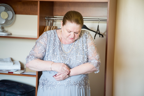 Bride fastening her bracelet at Bluebell Banqueting Suite Barnsley Wedding