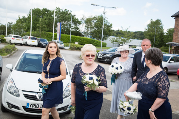 Bridal Party walking through the car park at Bluebell Banqueting Suite Barnsley Wedding