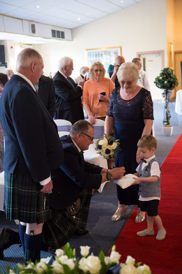 Ring Bearer givinbg rings to the best man at Bluebell Banqueting Suite Barnsley Wedding