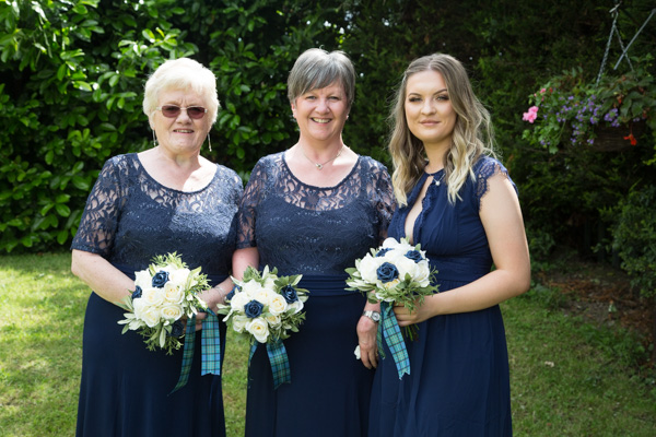 Bridemsiad in navy blue dresses at Bluebell Banqueting Suite Barnsley Wedding