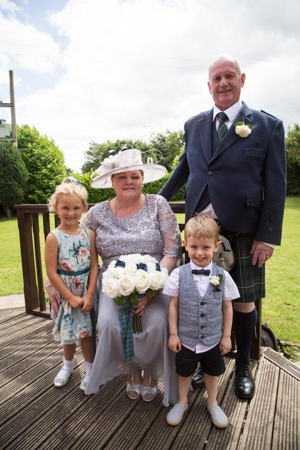 Bride and groom with their grandchildren at Bluebell Banqueting Suite Barnsley Wedding