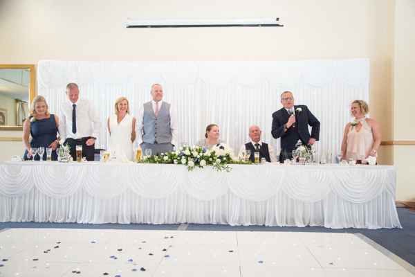 THe top table during wedding speeches at Bluebell Banqueting Suite Barnsley Wedding