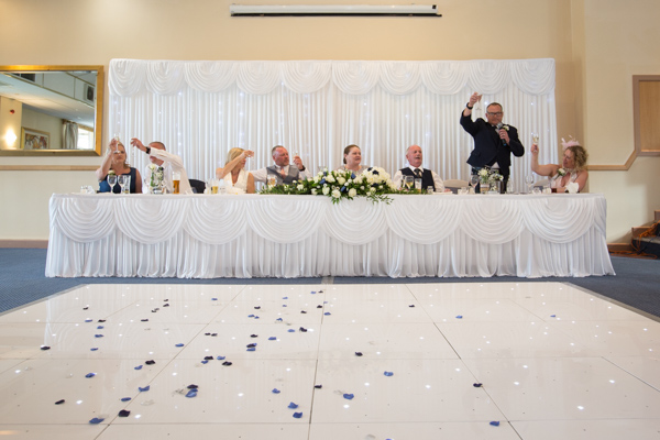 The top table raising a toast at Bluebell Banqueting Suite Barnsley Wedding