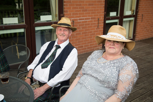 Bride and groom in matching hats at Bluebell Banqueting Suite Barnsley Wedding