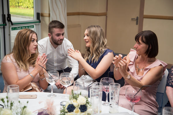 Guests dancing at the table at Bluebell Banqueting Suite Barnsley Wedding