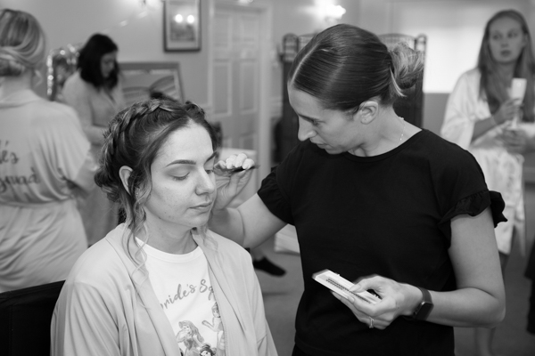 Bridesmaid having her makeup done at Bagden Hall Hotel Wedding