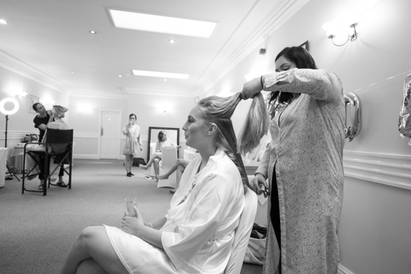 Bride having her hair done at Bagden Hall Hotel Wedding