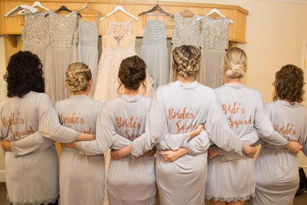 The bridesmaids with matching dressing gowns at Bagden Hall Hotel Wedding