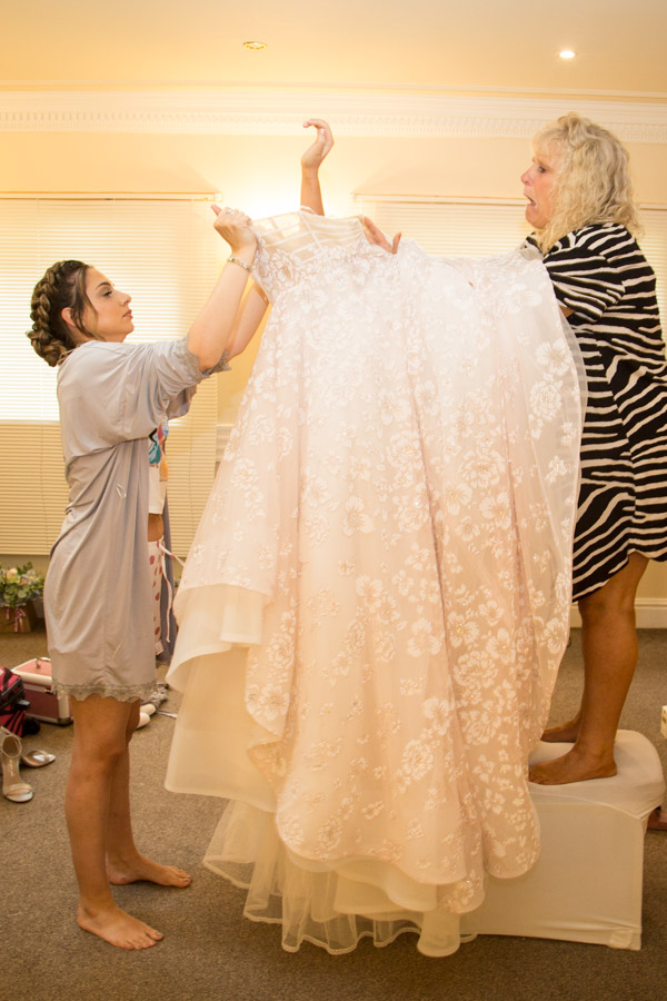 The bride getting into her dress at Bagden Hall Hotel Wedding