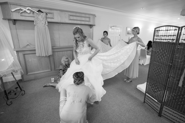 THe bride getting into her wedding dress at Bagden Hall Hotel Wedding