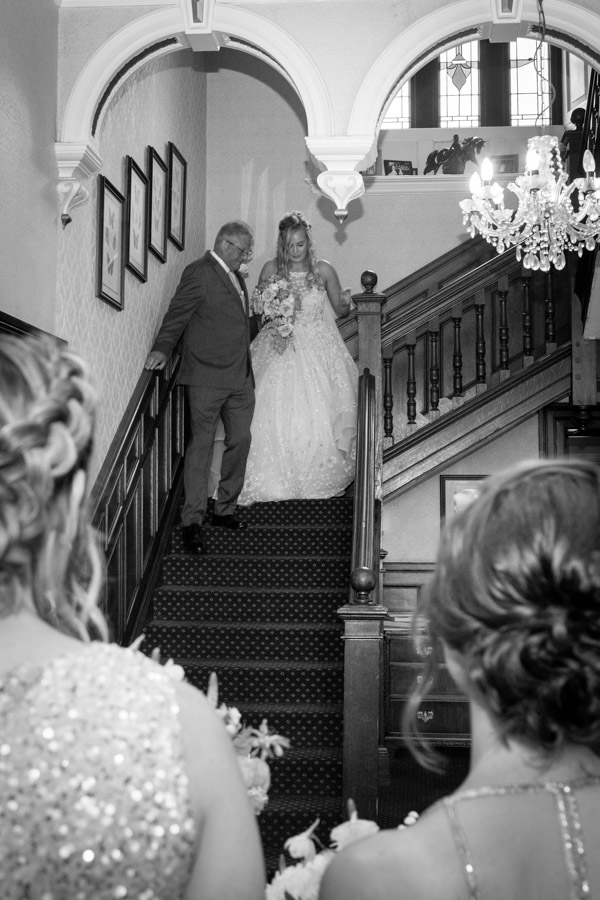 The bride walking downstairs at Bagden Hall Hotel Wedding